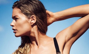 Doutzen showt killer body in Glamour swimwear shoot