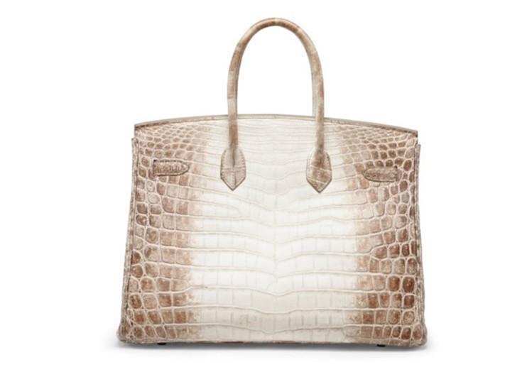 760e287d93a ... maar ongeveer twee van dit soort tassen worden gemaakt, omdat de  productie vand e bag en het verven van de krokodillenhuid zoveel tijd in  beslag neemt.